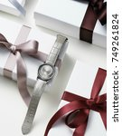 wrapped gift boxes with ladies... | Shutterstock . vector #749261824