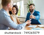 young couple with a real estate ... | Shutterstock . vector #749265079