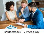young couple with a real estate ... | Shutterstock . vector #749265139