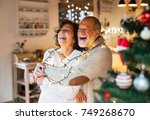 senior couple hugging at home... | Shutterstock . vector #749268670