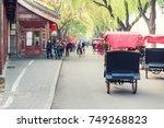tourists riding beijing... | Shutterstock . vector #749268823