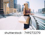 young woman with shopping bags  | Shutterstock . vector #749272270