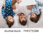 top view of happy handsome... | Shutterstock . vector #749275288