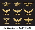 gold heraldic eagles logo... | Shutterstock .eps vector #749296078