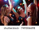 happy girls fun dansing at a... | Shutterstock . vector #749306698
