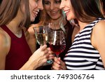 happy young women with glasses... | Shutterstock . vector #749306764