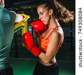 female on boxing class with her ... | Shutterstock . vector #749308084