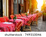 old street with tables of cafe... | Shutterstock . vector #749310046