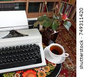 a typewriter  tea and a rose in ... | Shutterstock . vector #749311420