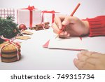 write wishing on the greeting... | Shutterstock . vector #749315734
