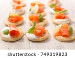 assorted canape with salmon | Shutterstock . vector #749319823