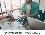 young asian freelance worker... | Shutterstock . vector #749322619