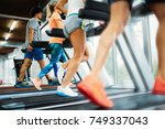 picture of people running on... | Shutterstock . vector #749337043
