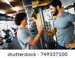 Two Young Men Meeting At Gym...