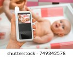 hand of mother is holding baby... | Shutterstock . vector #749342578
