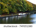 powerboat on the water on a... | Shutterstock . vector #749351380