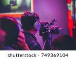 professional video technician... | Shutterstock . vector #749369104