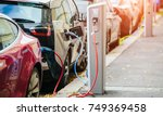 many electric car are charged... | Shutterstock . vector #749369458