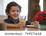 close up of smiling boy with... | Shutterstock . vector #749371618