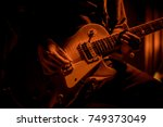 Guitarist Plays Guitar At A...