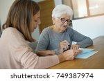 home assistant helping elderly... | Shutterstock . vector #749387974