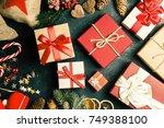 christmas presents on dark... | Shutterstock . vector #749388100