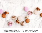 beautiful variety of macaroons... | Shutterstock . vector #749394709