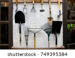 Gardening Tools On Cement Wall...