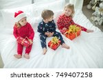 children in christmas | Shutterstock . vector #749407258