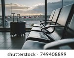 two traveler suitcases at the... | Shutterstock . vector #749408899
