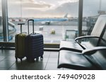 suitcases in airport waiting... | Shutterstock . vector #749409028
