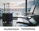 two traveler suitcases in the... | Shutterstock . vector #749409046