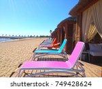 private sunbathing area and sun ... | Shutterstock . vector #749428624