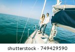young couple in love on sail... | Shutterstock . vector #749429590