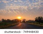 summer sunset over rural road... | Shutterstock . vector #749448430