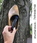 Small photo of A geo cache container, hidden in a wooden shoe