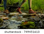Woman Hiker Crossing A Small...