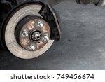 disc brake repair in garage. | Shutterstock . vector #749456674