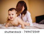 mom in white shirt plays with... | Shutterstock . vector #749473549