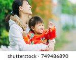 asian family portrait of 2... | Shutterstock . vector #749486890