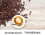 coffee cup and coffee beans on... | Shutterstock . vector #749489464