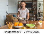 helping mother to set up a table | Shutterstock . vector #749492038