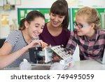teacher talking to female... | Shutterstock . vector #749495059