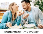 young couple enjoying... | Shutterstock . vector #749499889
