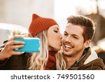 young smiling couple is... | Shutterstock . vector #749501560