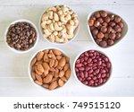 top view of assorted nuts | Shutterstock . vector #749515120