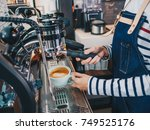 woman barista using machine... | Shutterstock . vector #749525176