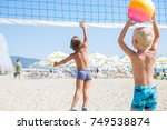 two young boys playing beach... | Shutterstock . vector #749538874