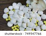 scattered medicine on a wooden... | Shutterstock . vector #749547766