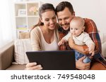 family  parenthood and people... | Shutterstock . vector #749548048